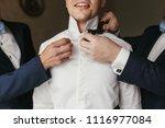 groomsmen helping groom getting ...   Shutterstock . vector #1116977084