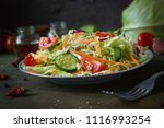fresh dietary salad of... | Shutterstock . vector #1116993254