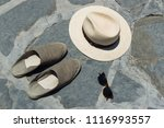 a panama hat  a pair of... | Shutterstock . vector #1116993557