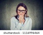Stock photo shy young woman looking at camera 1116996464