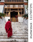Small photo of The beauty of Punakha Dzong is incomplete without its monks, drapped in red robe.