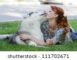 young happy woman with haski... | Shutterstock . vector #111702671