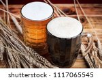two glasses brown and golden... | Shutterstock . vector #1117065545