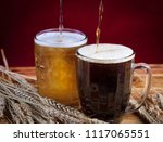 two glasses brown and golden... | Shutterstock . vector #1117065551
