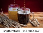 two glasses brown and golden... | Shutterstock . vector #1117065569