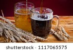 two glasses brown and golden... | Shutterstock . vector #1117065575