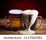 two glasses brown and golden... | Shutterstock . vector #1117065581