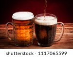 two glasses brown and golden... | Shutterstock . vector #1117065599