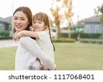 mother and daughter playing in...   Shutterstock . vector #1117068401