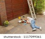 senior fell off ladder doing... | Shutterstock . vector #1117099361