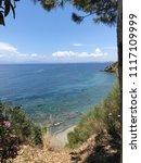 aegean coast  beach and cliffs. ... | Shutterstock . vector #1117109999