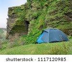 wild camping. tent near green...   Shutterstock . vector #1117120985