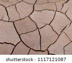 top view dry soil cracked... | Shutterstock . vector #1117121087
