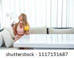 sexy woman smoke electronic... | Shutterstock . vector #1117151687