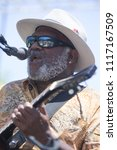 Small photo of Guerneville, CA/USA: 6/10/2018: Henry Saint Clair Fredericks aka Taj Mahal performs at the Russian River Blues Festival. He has received three Grammy Awards and ten nominations.
