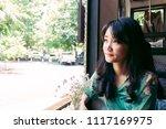 beautiful asian woman sitting... | Shutterstock . vector #1117169975