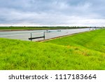 big barge and yacht navigating... | Shutterstock . vector #1117183664