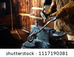 The Hands Of A Blacksmith At...