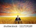businessman sitting on filed in ... | Shutterstock . vector #111719189