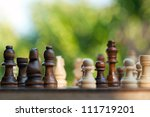 chess pieces on a table in the... | Shutterstock . vector #111719201