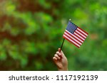 with american flag in her hand... | Shutterstock . vector #1117192139