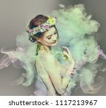 the lady of flowers is half... | Shutterstock . vector #1117213967