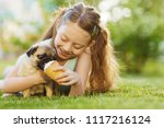 Little Girl Kid Feeding Pug Dog ...