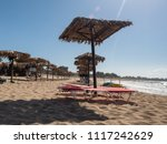 sunshades on the beach at... | Shutterstock . vector #1117242629
