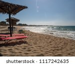 sunshades on the beach at... | Shutterstock . vector #1117242635