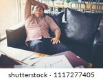 businessman feeling worried and ... | Shutterstock . vector #1117277405