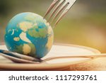 fork slammed on globe model... | Shutterstock . vector #1117293761