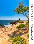 lighthouse at coast of colonia... | Shutterstock . vector #1117294781