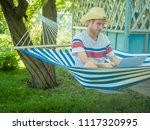 young freelancer sitting in...   Shutterstock . vector #1117320995
