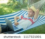 young male freelancer working...   Shutterstock . vector #1117321001
