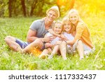 happy parents with their two... | Shutterstock . vector #1117332437