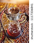 frozen coffee on hot day | Shutterstock . vector #1117336841
