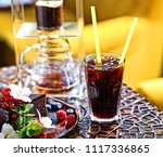 iced coffee and cake | Shutterstock . vector #1117336865