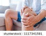 man suffering from knee pain... | Shutterstock . vector #1117341581