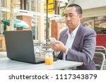 asian businessman use wireless...   Shutterstock . vector #1117343879