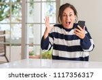 middle aged woman using... | Shutterstock . vector #1117356317