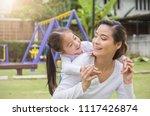 portrait of happy asian mother... | Shutterstock . vector #1117426874