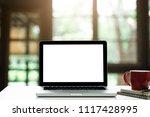 workspace wood desk with laptop ...   Shutterstock . vector #1117428995