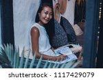 beauty woman using notebook ...   Shutterstock . vector #1117429079