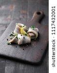 classic marinated herring rolls ... | Shutterstock . vector #1117432001