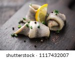 Stock photo classic marinated herring rolls with chives and lemon 1117432007
