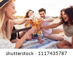 happy young friends 20s in... | Shutterstock . vector #1117435787