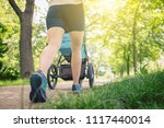 walking woman with baby... | Shutterstock . vector #1117440014