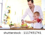 image of man and son preparing... | Shutterstock . vector #1117451741