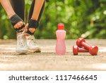 close up of sportswoman tying... | Shutterstock . vector #1117466645