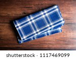 checkered blue napkin on an old ... | Shutterstock . vector #1117469099